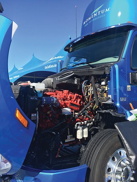 SoCalGas shows one engine that his helping drive down greenhouse gas emissions on dairies at this week's World Ag Expo. submitted photo